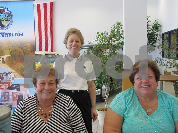 Linda Donner, Cheryl Lychwick, and Barb Michaels were were on hand to promote the Dragon Boat Bash to be held in August.