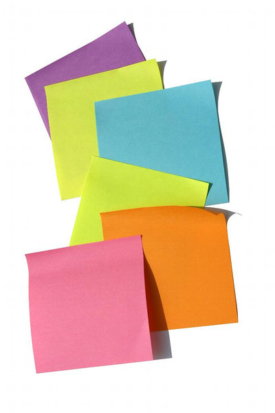 A cascading backdrop of brightly colored post-it notes. Beauty in paper form.