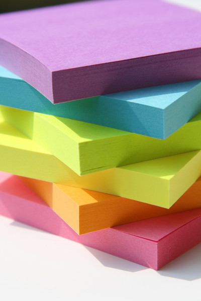 A rainbow assortment of sticky note pads.