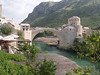 The famous Mostar bridge, a pedestrian bridge that joins the Muslim and Christian sides of the city.  Rebuilt in 2004.