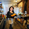 Owner Gloria Castano poses with one of her fresh breads in the kitchen / baking area of her business, Sweet Creations by Gloria at 5 West St. in downtown Leominster, Wednesday. Her fresh breads go for $8 a loaf.<br /> SENTINEL & ENTERPRISE / BRETT CRAWFORD