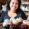Owner Gloria Castano stands with an assortment of her cupcakes at her business, Sweet Creations by Gloria at 5 West St. in downtown Leominster, Wednesday.  All of her cupcakes can be made to be vegan and gluten-free. Each one sells for $2.25.<br /> SENTINEL & ENTERPRISE / BRETT CRAWFORD