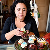 Owner Gloria Castano places an assortment of her cupcakes onto a platter at her business, Sweet Creations by Gloria at 5 West St. in downtown Leominster, Wednesday.  All of her cupcakes can be made to be vegan and gluten-free. Each one sells for $2.25.<br /> SENTINEL & ENTERPRISE / BRETT CRAWFORD