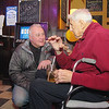 One of the original owners of The Boulder in Fitchburg Chris Bicoules, 92, chats with Ward 3 Councilor Joel Kaddy during the bar's 80th celebration on Tuesday night. SENTINEL & ENTERPRISE/JOHN LOVE