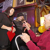 Fitchburg's Mayor Lisa Wong and The Boulders owner Rhea Bujold chat with Chris Bicoules, 92, one of the original owners of the bar during its 80th birthday celebration on Tuesday night.  SENTINEL & ENTERPRISE/JOHN LOVE