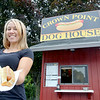 A new hot dog stand opened up in Fitchburg, owned by Sean Morrison, about two months ago called the Dog House in the parking lot of the Crown Point office center at 76 Summer Street. Employee Aamanda Tarbell shows off one of their hot-dogs. SENTINEL & ENTERPRISE/JOHN LOVE