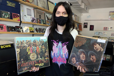 Zack Frediani works at The Vinyl Vault in Littleton, with some Beatles albums. The store sells records including LPs and 45s, as well as cassettes and DVDs. His father Greg Frediani owns the store.  SUN/Julia Malakie