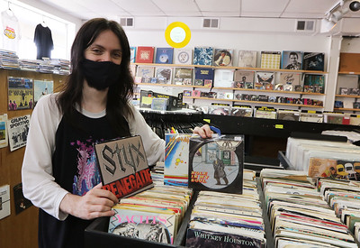 Zack Frediani works at The Vinyl Vault in Littleton, which sells records including LPs and 45s, as well as cassettes and DVDs. His father Greg Frediani owns the store. These are 45s. SUN/Julia Malakie