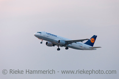 Düsseldorf, Germany - September 25, 2011: Lufthansa Airbus A320 in climb flight over International Airport in Düsseldorf. This aircraft is a short- to medium-range commercial passenger jet airliner with a seating capacity of about 160.