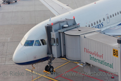 Düsseldorf, Germany - September 25, 2011: Airbus A319 of British Airways with passenger boarding bridge on gate of International Airport in Düsseldorf, Germany. This aircraft is a short- to medium-range commercial passenger jet airliner with a seating capacity of about 130.