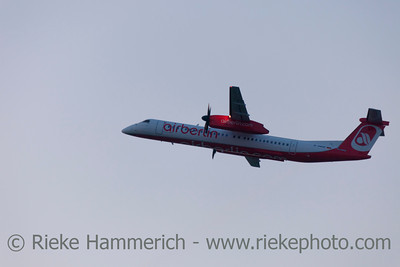 Düsseldorf, Germany - September 25, 2011: Turboprop Airliner De Havilland Canada DHC-8-402Q Dash 8 of Air Berlin in climb flight over International Airport in Düsseldorf, Germany. This aircraft has a cruise speed of 667km/h (360 knots) and transports about 78 passengers.