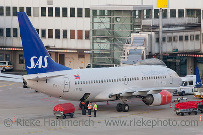 Düsseldorf, Germany - September 25, 2011: Boeing 737 of Scandinavian Airlines (SAS) at gate of International Airport in Düsseldorf, Germany ready for boarding and loading luggage. The Boeing 737 is a short- to medium-range airliner and has a seating capacity of about 140.