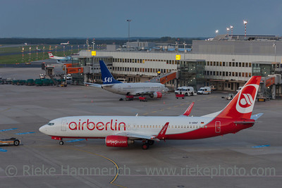 Düsseldorf, Germany - September 25, 2011: Boeing 737 of Air Berlin rolling to runway on International Airport in Düsseldorf, Germany. In the background a Boeing 737 of Scandinavian Airlines (SAS) at the gate ready for boarding.