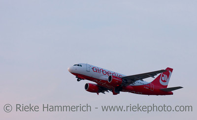 Düsseldorf, Germany - September 25, 2011: Airbus A 319 of Air Berlin in climb flight over International Airport in Düsseldorf, Germany. This airplane is a short- to medium-range commercial passenger jet airliner with a seating capacity of about 130.