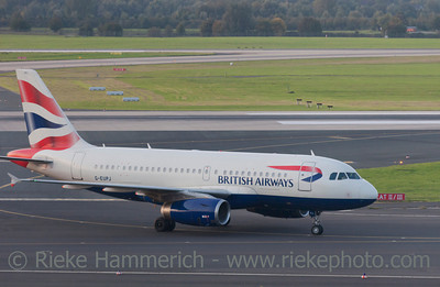 Düsseldorf, Germany - September 25, 2011: Airbus A319 of British Airways rolling to gate after landing on International Airport in Düsseldorf, Germany. This aircraft is a short- to medium-range commercial passenger jet airliner with a seating capacity of about 130.