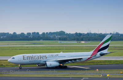 Düsseldorf, Germany - September 25, 2011: Airbus A330 of Emirates rolling to gate after landing on International Airport in Düsseldorf, Germany. This aircraft is a wide-body twin-engine jet airliner with a range of more than 13.000 km and a seating capacity of about 250.
