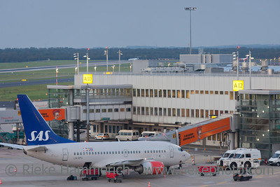 Düsseldorf, Germany - September 25, 2011: Boeing 737 of Scandinavian Airlines (SAS) ready for boarding at the gate on International Airport in Düsseldorf, Germany. The Boeing 737 is a short- to medium-range airliner and has a seating capacity of about 140.