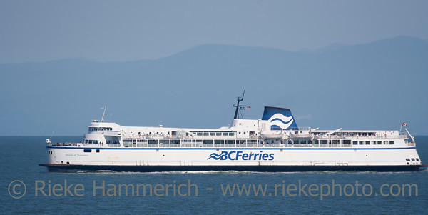 "Southern Gulf Islands, British Columbia, Canada – August 4, 2005: Ferry ""Queen of Vancouver"" of BC Ferries is passing the Southern Gulf Islands in Canada. The Ferry Ride from Swartz Bay on Vancouver Island to Tsawassen is a touristic highlight in British Columbia."