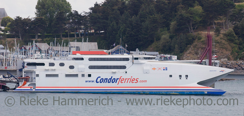 SAINT-MALO, FRANCE - JULY 6: Ferry 'Condor Rapide' of Condor Ferries in the harbor of Saint-Malo, France on July 6, 2011. This fast catamaran is 86 meter long (282 ft) and has a speed of 48 knots.