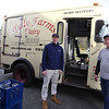 Tully Farms Dairy in Dunstable is doing more delivery business due to the Covid-19 pandemic. Charlie Tully, right, and his nephew Zack Millett, 17, both of Dunstable, after a busy delivery run. (SUN/Julia Malakie)
