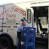 Tully Farms Dairy in Dunstable is doing more delivery business due to the Covid-19 pandemic. Charlie Tully unloads empties from the truck after a busy delivery run. (SUN/Julia Malakie)