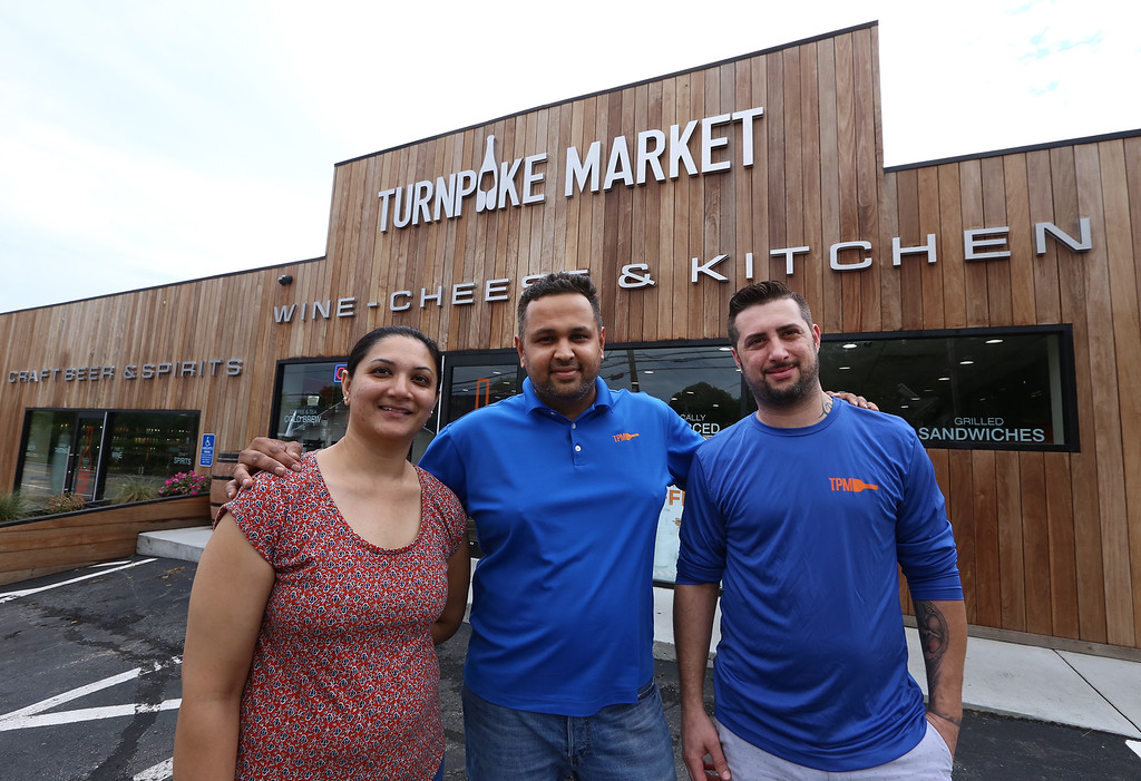 . Turnpike Market on Middlesex Turnpike in Billerica. From left, owners Kinnari and husband Sam Patel of Billerica, and chef Fernando Gravena of Lowell. (SUN/Julia Malakie)