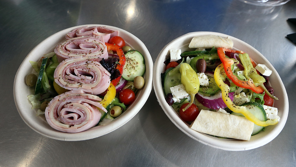 . Turnpike Market on Middlesex Turnpike in Billerica. Meals to go: antipasto, left, and Greek salad. (SUN/Julia Malakie)