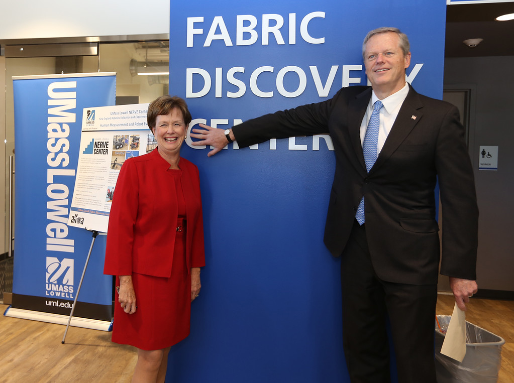 . Gov. Charlie Baker with UML chancellor Jacquie Moloney, before the opening ceremony and ribbon-cutting for the UMass Lowell Fabric Discovery Center at 110 Canal. (SUN/Julia Malakie)