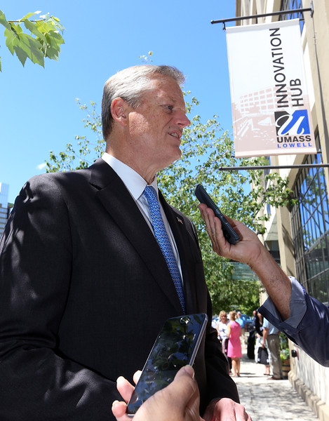 Gov. Charlie Baker takes a few questions from reporters after attending the opening ceremony and ribbon-cutting for the UMass Lowell Fabric Discovery Center at 110 Canal. (SUN/Julia Malakie)