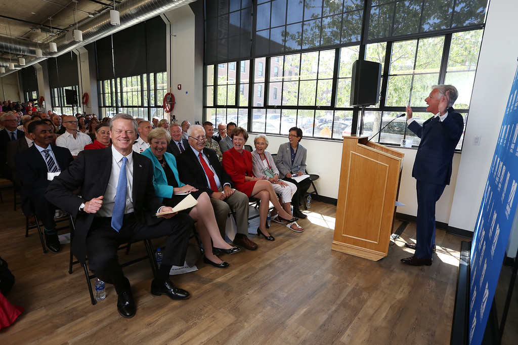 . Gov. Charlie Baker attends opening ceremony and ribbon-cutting for the UMass Lowell Fabric Discovery Center at 110 Canal. Baker, left, reacts as he\'s introduced by UMass president Marty Meehan. (SUN/Julia Malakie)