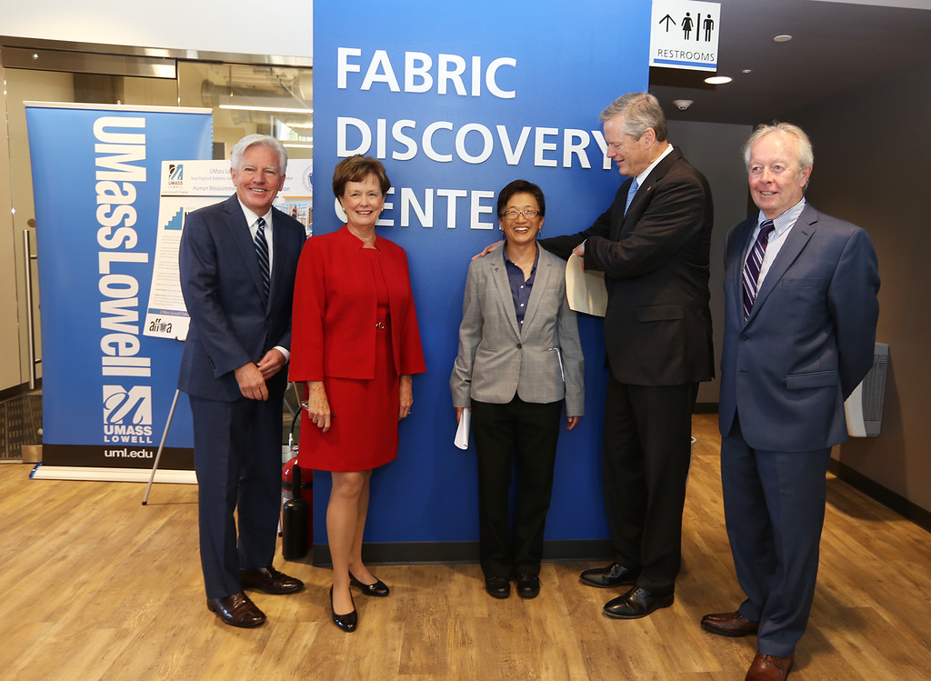 . Gov. Charlie Baker attends opening ceremony and ribbon-cutting for the UMass Lowell Fabric Discovery Center at 110 Canal. Gathering for a photo before the ceremony, from left: UMass president Marty Meehan, UML chancellor Jacquie Moloney, vice chancellor for Research & Innovation Julie Chen, Baker, and Lowell city councilor Edward Kennedy. (SUN/Julia Malakie)