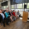 Gov. Charlie Baker attends opening ceremony and ribbon-cutting for the UMass Lowell Fabric Discovery Center at 110 Canal. Baker, left, reacts as UMass president Marty Meehan starts to tell a story Baker likes to tell. (SUN/Julia Malakie)