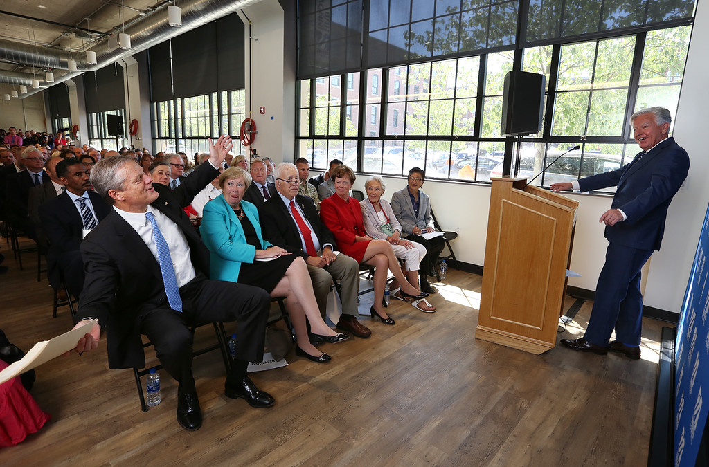 . Gov. Charlie Baker attends opening ceremony and ribbon-cutting for the UMass Lowell Fabric Discovery Center at 110 Canal. Baker, left, reacts as UMass president Marty Meehan starts to tell a story Baker likes to tell. (SUN/Julia Malakie)