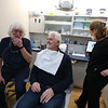 Billerica dentist Paul Feuerstein of Lowell, left, recently named one of the world's top 100 dentists, at Billerica Dental Associates, with patient Jerry Giuliano of Wakefield and certified dental assistant Karla Brink of Chelmsford.  (SUN/Julia Malakie)