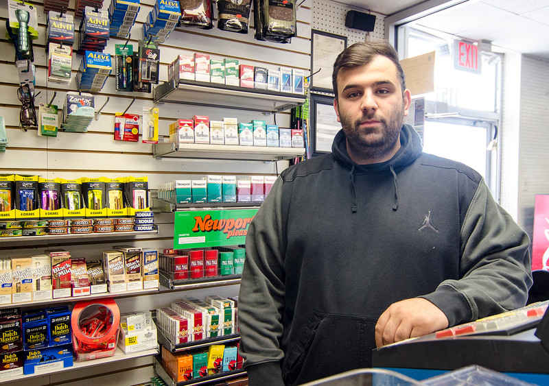 "Bobby Amanatidis, the owner of the Greek Town Market in Fitchburg, said if the regulation did go into effect, it would hurt his business ""terribly."" But he also thinks it will hurt local businesses in surrounding communities as well. He said customers who are below 21 will just take the 15-minute drive across the border into New Hampshire to buy tobacco products. SENTINEL & ENTERPRISE / Ashley Green"