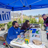 Courtney Morse and 1-year-old Shane speak with Unitil's Dave Clapham and Hillary Flanagan during the Unitil's second Annual Energy Saving Trees Community Event at Lakeview Nurseries in Lunenburg on Saturday afternoon. SENTINEL & ENTERPRISE / Ashley Green