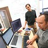 BEN GARVER — THE BERKSHIRE EAGLE<br /> James Kupernik, chief technology officer for VidMob in Pittsfield, works with software engineer Joe Monti. The company is still growing at a steady pace and is filling the second floor of the Crawford Square Building. Thursday, September 5, 2019. VidMob is a platform that connects video creators with clients.
