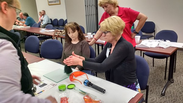 Class participants learn how to lift Fingerprints.