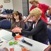 Class participants learn how to lift Fingerprints.