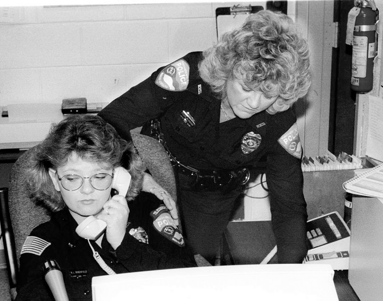 12/5/95  WAYNESVILLE POLICE DISPATCHER KAREN BURCHFIELD,  LEFT, LOGS INFORMATION INTO THE DEPARTMENT'S NEW COMPUTERIZED COMMUNICATIONS SYSTEM WHILE OFFICER SYLVIA MCMAHAN LOOKS ON.
