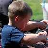 """Kayla Rice/Reformer                                <br /> Henry Perkins, 4, of Jericho, Vt. makes a necklace """"for mommy"""" at the Wardsboro Public Library's summer youth program."""