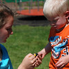 Kayla Rice/Reformer                                <br /> Kristen Perkins, 15, helps her nephew, Colin Perkins, 2, of Jericho make a necklace during the Wardsboro Public Library's summer youth program.