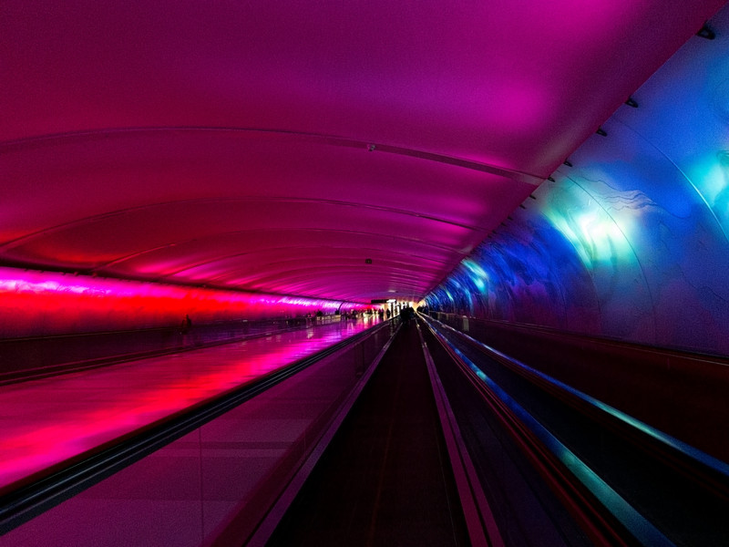Detroit Airport underground multi-media tunnel to terminals - it was making noise of a thunder storm with rain
