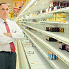 Manager of the Water Street Market Basket John Sevastis stands next to some empty shelves in his store. SENTINEL & ENTERPRISE/JOHN LOVE
