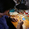 Family-owned-company, Wee Forest Folk, makes miniatures in Carlisle. Mai To of Acton works on assembly, putting mice on their stands. (SUN/Julia Malakie)