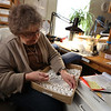 Family-owned-company, Wee Forest Folk, makes miniatures in Carlisle. Mary Severance of Westford lines up pieces for airbrushing. Some employees do airbrushing at home some of the time. (SUN/Julia Malakie)