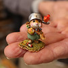Family-owned-company, Wee Forest Folk, makes miniatures in Carlisle. Willy Petersen holds a Johnny Appleseed miniature. (SUN/Julia Malakie)