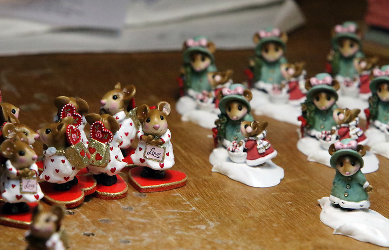 """Family-owned-company, Wee Forest Folk, makes miniatures in Carlisle. Miniatures in process, waiting to be detailed, including """"Loving You!"""" at left, on of company founder Annette Petersen's designs.(SUN/Julia Malakie)"""