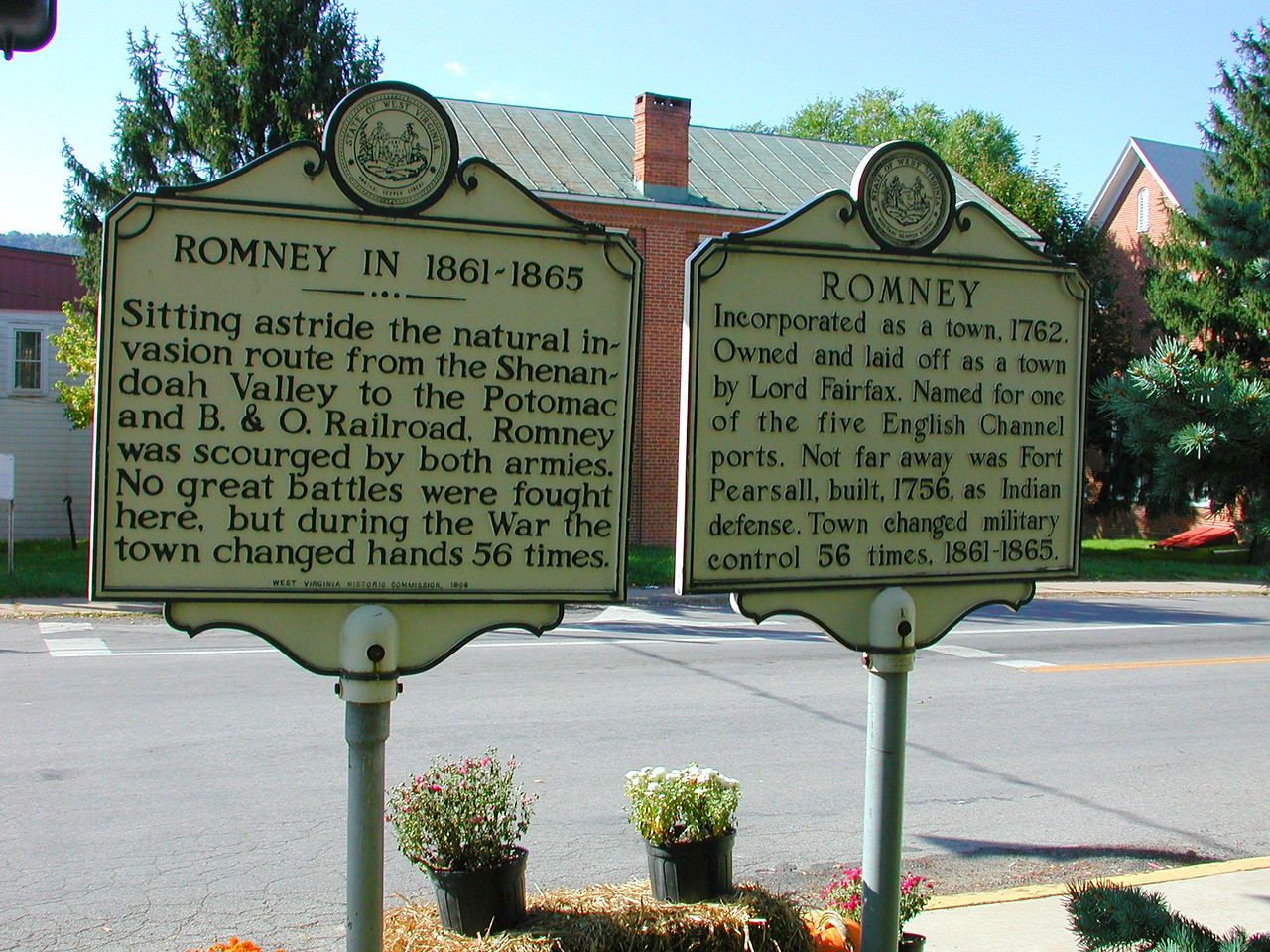 These signs by the courthouse in Romney, West Virginia tell an interesting story.