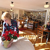 Muffins on Main celebrated three years in business on Main Street in Westford Center in December. Server Dotty McMillan of Westford, left, tidies up. At right is regular customer Mary Lyman of Westford. (SUN/Julia Malakie)